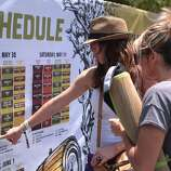 Crissie Salas, left, and Jessie Swartz of Grass Valley figure out which acts they want to see at the 2014 Bottlerock Napa Valley music, food and wine festival on Friday, May 30, 2014 in Napa, Calif.