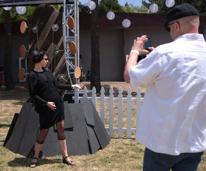 Edmee Mohnike of Chico poses in front of a large guitar headstock as husband Charles Mohnike snaps a photo at the 2014 Bottlerock Napa Valley Music Festival on Friday, May 30, 2014 in Napa, Calif. Photo: Kevin N. Hume, The Chronicle