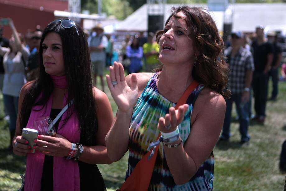 Napa residents Amy Jabin, left, and Katie Aaron watch the band Sielle at the Miner Family Winery Stage at the 2014 Bottlerock Napa Valley music, food and wine festival on Friday, May 30, 2014 in Napa, Calif. Photo: Kevin N. Hume, The Chronicle