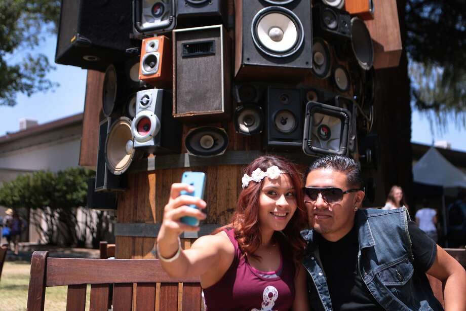 Karen Lopez and Carlos De La Cruz of San Jose take a selfie in front of an art structure of speakers attached to a large barrel at the 2014 Bottlerock Napa Valley music, food and wine festival on Friday, May 30, 2014 in Napa, Calif. Photo: Kevin N. Hume, The Chronicle