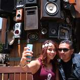 Karen Lopez and Carlos De La Cruz of San Jose take a selfie in front of an art structure of speakers attached to a large barrel at the 2014 Bottlerock Napa Valley music, food and wine festival on Friday, May 30, 2014 in Napa, Calif.