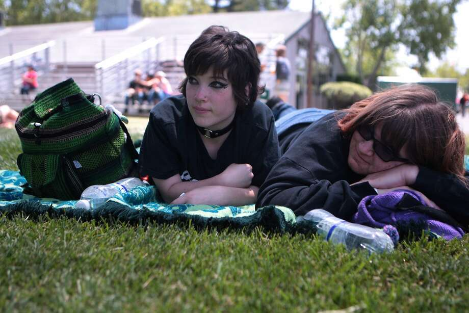 Brianna Sieren, left, of Sonoma and Kristy Grindle of Petaluma relax in the shade at the Miner Family Winery Stage at the 2014 Bottlerock Napa Valley music, food and wine festival on Friday, May 30, 2014 in Napa, Calif. Photo: Kevin N. Hume, The Chronicle
