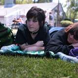 Brianna Sieren, left, of Sonoma and Kristy Grindle of Petaluma relax in the shade at the Miner Family Winery Stage at the 2014 Bottlerock Napa Valley music, food and wine festival on Friday, May 30, 2014 in Napa, Calif.
