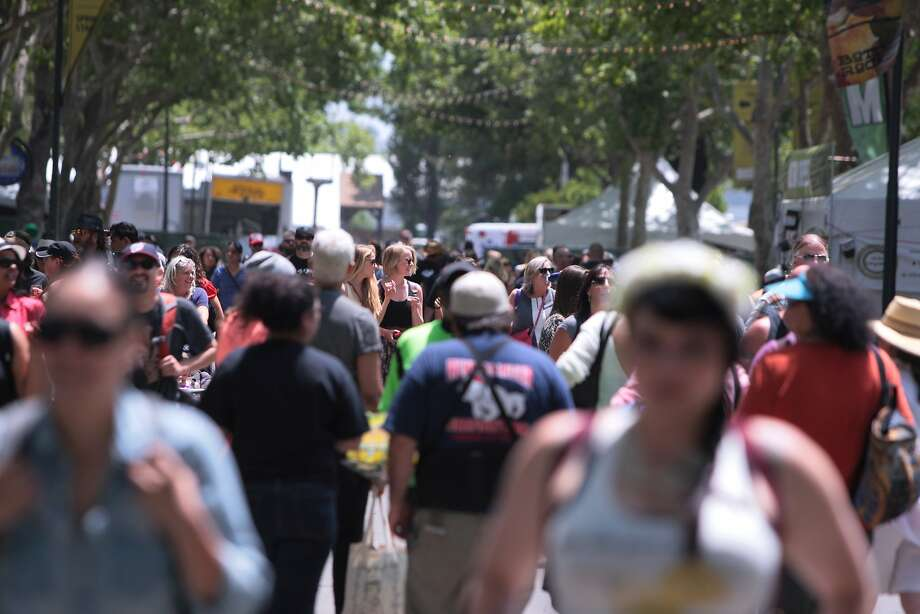 Fans walk down Main Street at the Napa Valley Expo during the 2014 Bottlerock Napa Valley music, food and wine festival on Friday, May 30, 2014 in Napa, Calif. Photo: Kevin N. Hume, The Chronicle