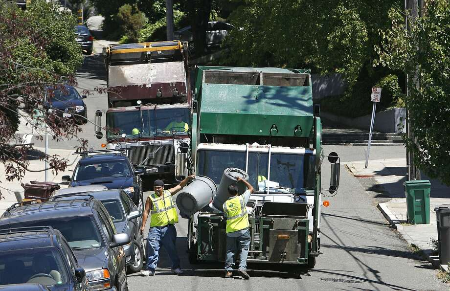 Oakland trash hauler Waste Management pays the city a $30 million fee, which comes out of residents' pockets. Photo: Michael Macor, SFC