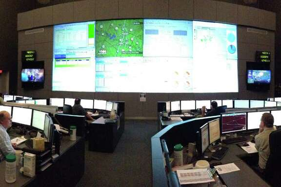 The Electric Reliability Council of Texas operates much of the state's grid from this Austin control center. An ERCOT consultant says power generators are prohibited from withholding power to influence prices.