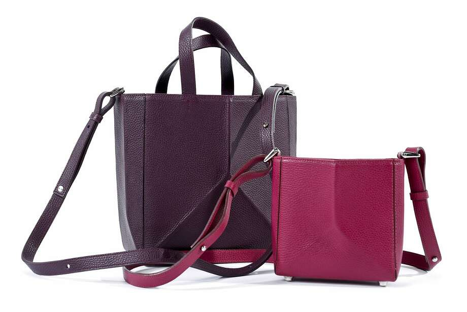 The Common Knowledge Bone Bag in oxblood (small, $480) and plum (large, $680). Photo: Russell Yip, The Chronicle