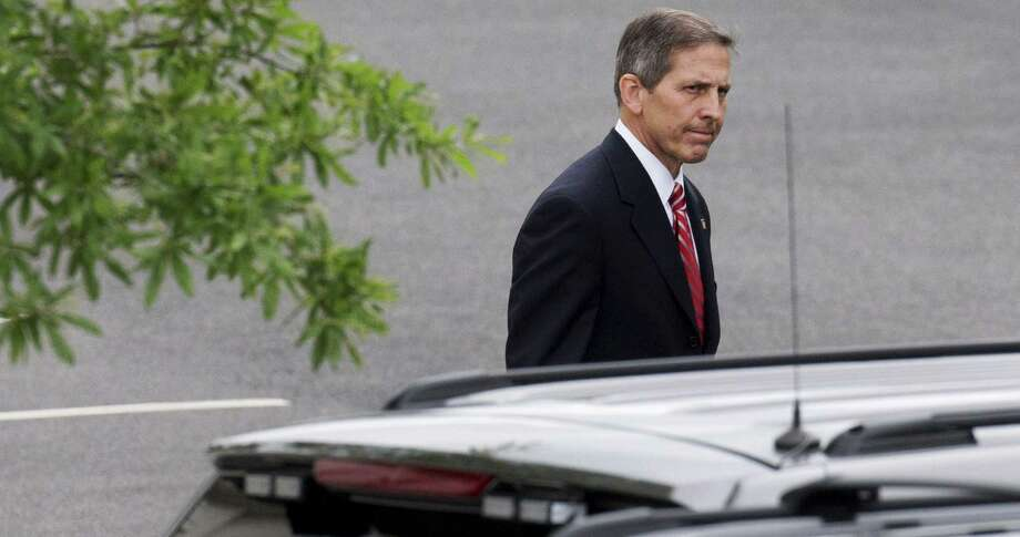 Deputy Veterans Affairs Secretary Sloan Gibson leaves the White House after being named by President Barack Obama to run the Veterans Affairs Department on an interim basis after the resignation of VA Secretary Eric Shinseki. Photo: Jacquelyn Martin / Associated Press / AP