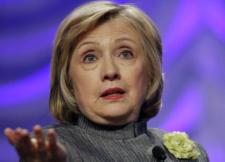 """Hillary Clinton: """"Those who exploit this tragedy over and over as a political tool mini- mize the sacrifice of those who served our country."""" Photo: Charles Dharapak / Associated Press / AP"""