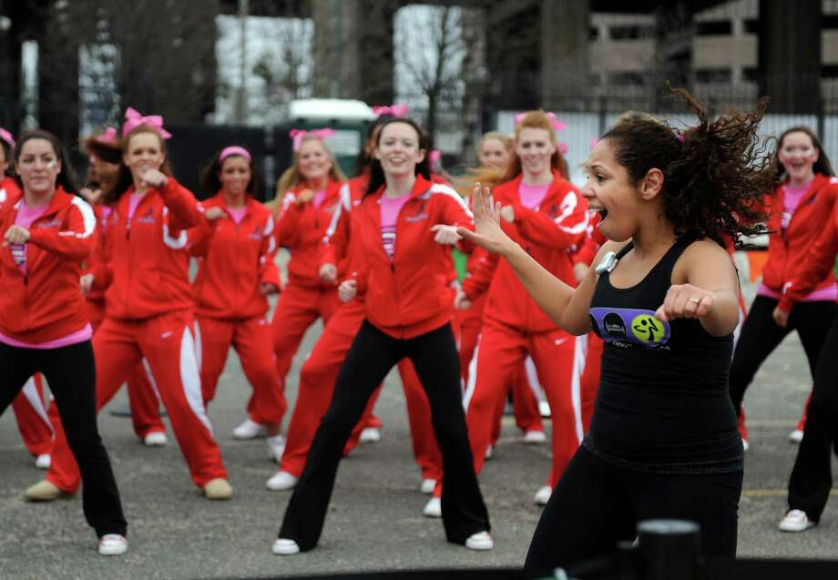 Instructor Simone Lima leads the Fairfield University cheerleaders and dance team in Zumba Saturday, March 5, 2011 during the sixth annual Park City SportsFest in downtown Bridgeport, Conn. Photo: Autumn Driscoll, ST / Connecticut Post