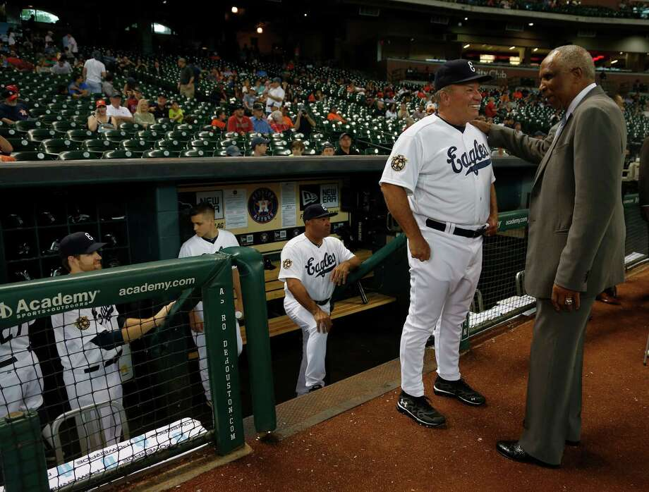 Astros bench coach Dave Trembley, left, swaps tales with Hall of Famer Frank Robinson before Friday's annual MLB Civil Rights Game at Minute Maid Park. Photo: Karen Warren, Staff / © 2014 Houston Chronicle
