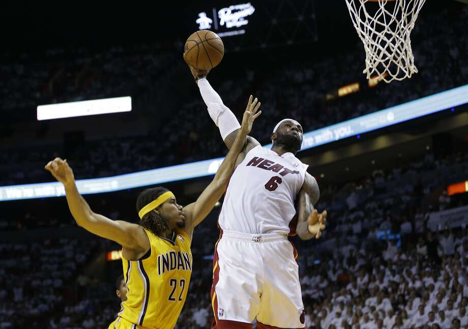 LeBron James, who had 25 points, goes to the rim against Chris Copeland in the second half. Photo: Lynne Sladky, Associated Press