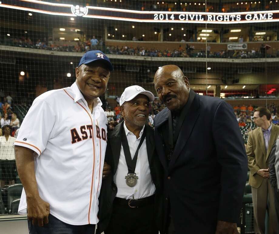 George Foreman, left, poses with MLB Beacon Award honorees Berry Gordy, center, and Jim Brown before the start of the annual MLB Civil Rights game. Photo: Karen Warren, Houston Chronicle