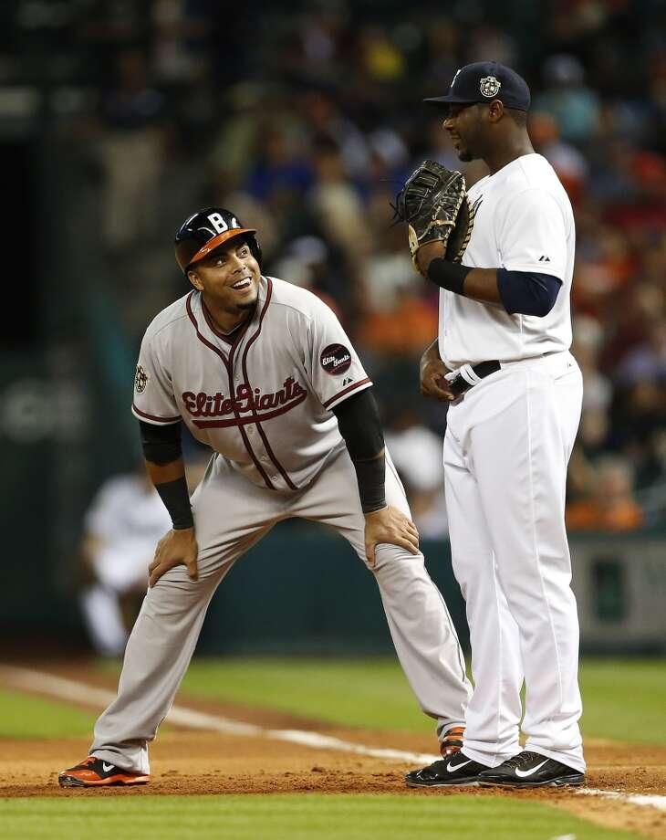 Orioles left fielder Nelson Cruz, left, chats with Chris Carter of the Astros. Photo: Karen Warren, Houston Chronicle