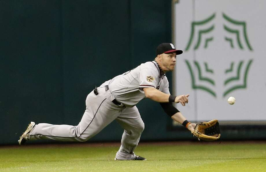 Orioles first baseman Steve Pearce makes a diving catch on a line out. Photo: Karen Warren, Houston Chronicle