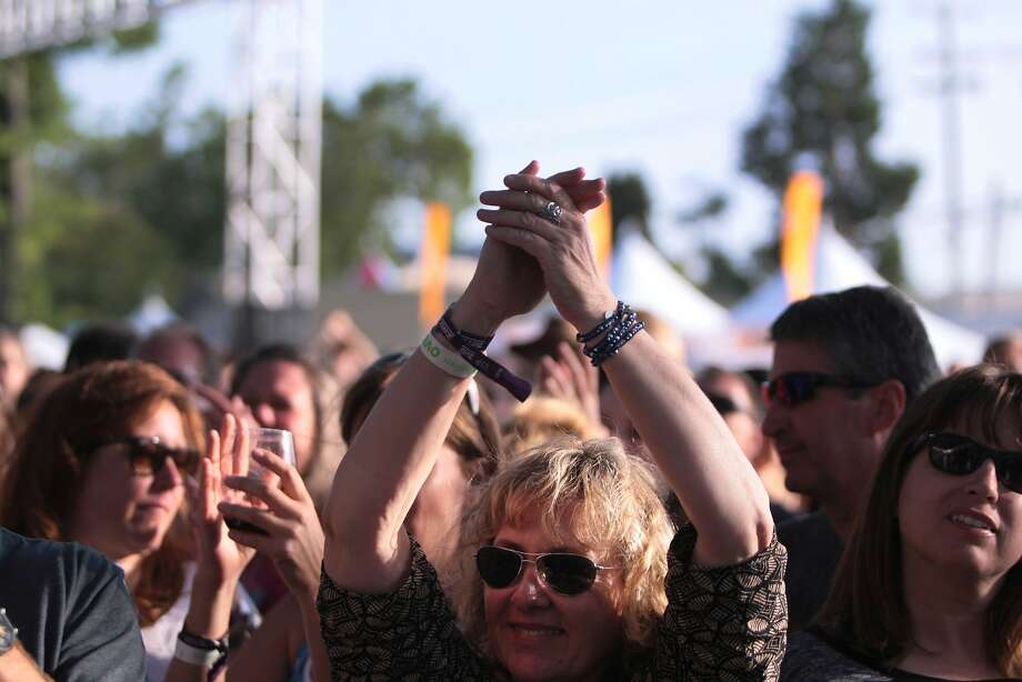 A fan applauds during the Gin Blossoms' set at the 2014 Bottlerock Napa Valley music, food and wine festival on Friday, May 30, 2014 in Napa, Calif. Photo: Kevin N. Hume, The Chronicle