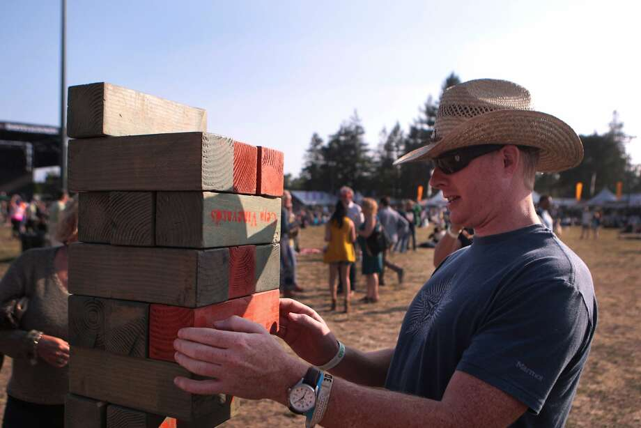 Scot Spelling of Aliso Viejo, Calif. plays a super-sized game of Jenga at the Ceja Winery booth at the 2014 Bottlerock Napa Valley music, food and wine festival on Friday, May 30, 2014 in Napa, Calif. Photo: Kevin N. Hume, The Chronicle
