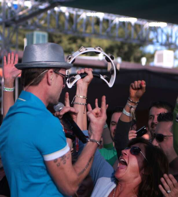 Robin Wilson, lead singer for the Gin Blossoms gives fan Tracy Corallo of Moraga a tambourine during the band's set at the 2014 Bottlerock Napa Valley music, food and wine festival on Friday, May 30, 2014 in Napa, Calif. Photo: Kevin N. Hume, The Chronicle