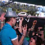 Robin Wilson, lead singer for the Gin Blossoms gives fan Tracy Corallo of Moraga a tambourine during the band's set at the 2014 Bottlerock Napa Valley music, food and wine festival on Friday, May 30, 2014 in Napa, Calif.