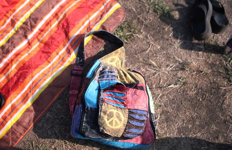 A colorful backpack and blanket lay on the lawn in front of the Toshiba Stage at the 2014 Bottlerock Napa Valley music, food and wine festival on Friday, May 30, 2014 in Napa, Calif. Photo: Kevin N. Hume, The Chronicle