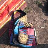A colorful backpack and blanket lay on the lawn in front of the Toshiba Stage at the 2014 Bottlerock Napa Valley music, food and wine festival on Friday, May 30, 2014 in Napa, Calif.
