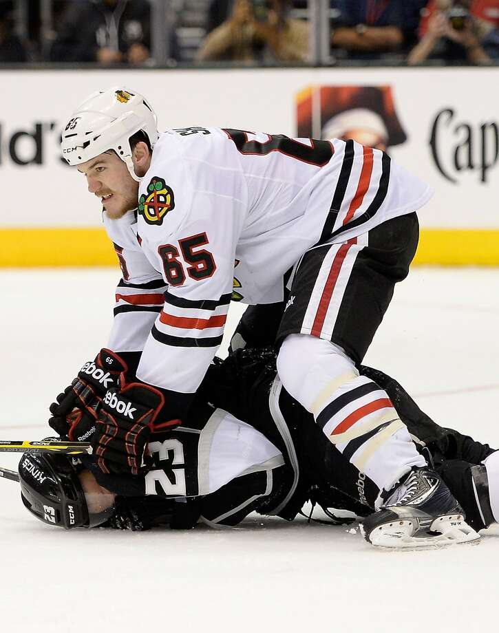 Chicago's Andrew Shaw pins Dustin Brown to the ice in the second period. Photo: Harry How, Getty Images