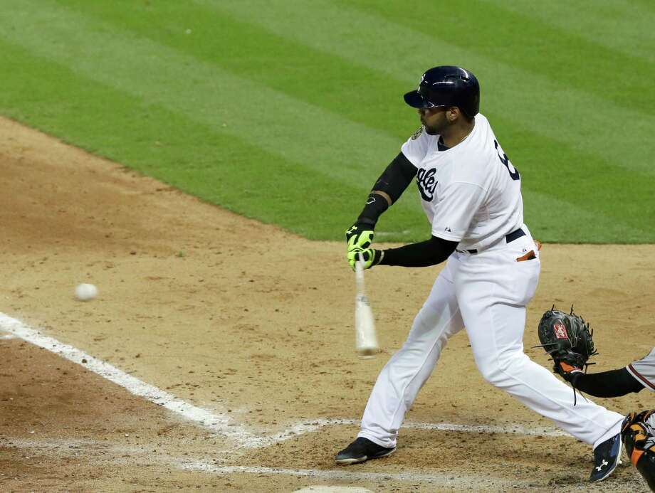 Houston Astros' Jonathan Villar swings for an RBI ground-rule double against the Baltimore Orioles in the seventh inning of Major League baseball's annual Civil Rights Game Friday, May 30, 2014, in Houston. (AP Photo/Pat Sullivan) ORG XMIT: HTA111 Photo: Pat Sullivan / AP
