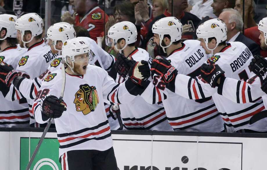 Chicago Blackhawks right wing Patrick Kane celebrates his goal against the Los Angeles Kings during second period of Game 6 of the Western Conference finals of the NHL hockey Stanley Cup playoffs in Los Angeles. Friday, May 30, 2014. (AP Photo/Chris Carlson) ORG XMIT: LAS104 Photo: Chris Carlson / AP