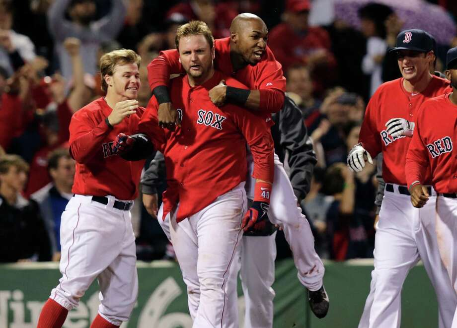 Boston Red Sox's A.J. Pierzynski is congratulated by teammates after his game-winning RBI triple in the bottom of the 10th inning off Tampa Bay Rays relief pitcher Juan Carlos Oviedo during a baseball game at Fenway Park in Boston, Friday, May 30, 2014. The Red Sox defeated the Rays 3-2. (AP Photo/Charles Krupa) ORG XMIT: MACK120 Photo: Charles Krupa / AP