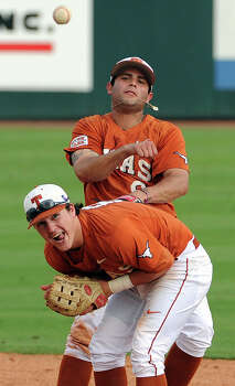 Texas' C.J. Hinojosa turns a ninth-inning double play with a nifty throw over teammate Brooks Marlow. Photo: Eric Christian Smith, MBO / Houston Chronicle