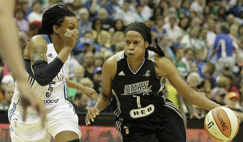 Stars guard Jia Perkins pushes the ball downcourt against the Lynx's Tan White. Perkins had a team-high 15 points. Photo: Stacy Bengs / Associated Press / FR170489 AP