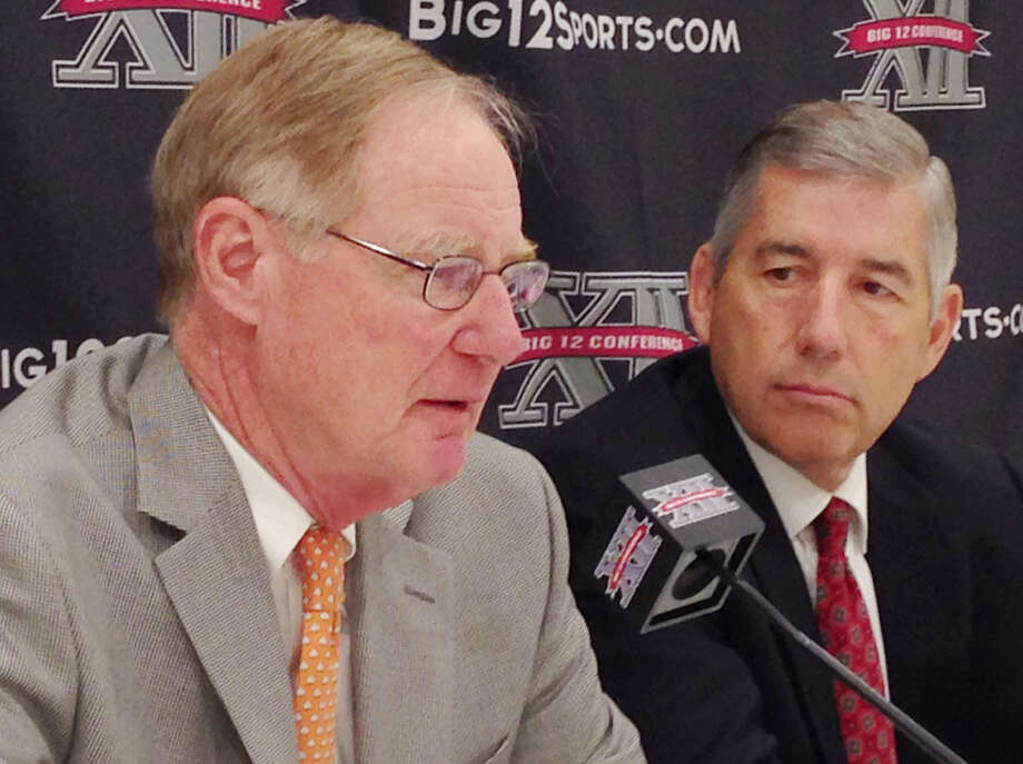Oklahoma St. president and Big 12 board chairman Burns Hargis (left) and Big 12 commissioner Bob Bowlsby meet with reporters at the end of the conference's annual spring meetings Friday. Photo: Stephen Hawkins / Associated Press / AP