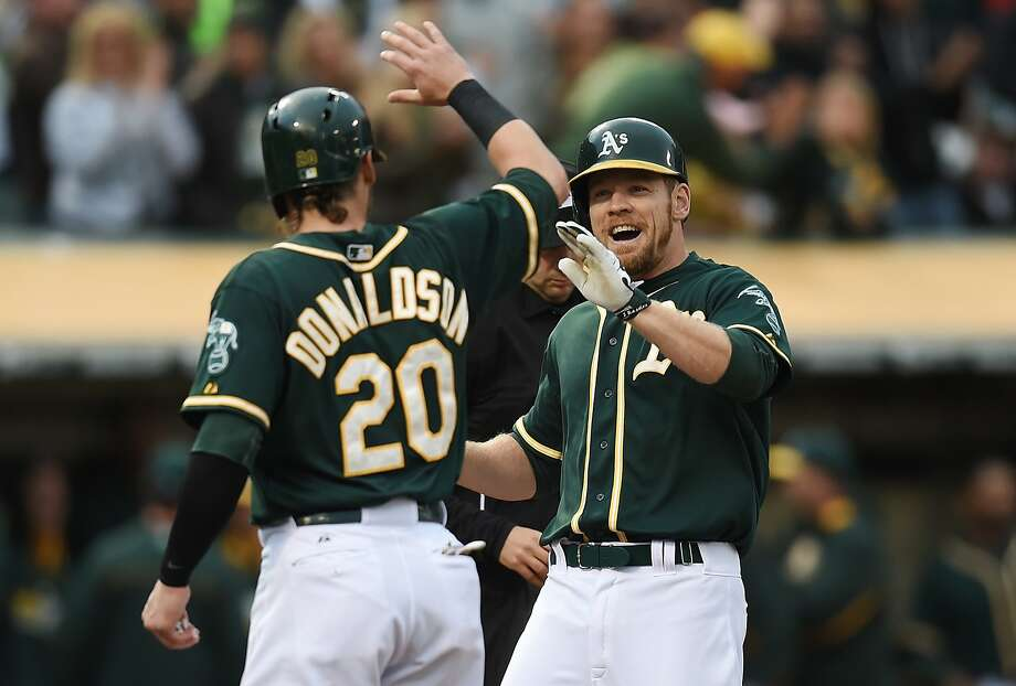 Josh Donaldson greets Brandon Moss after Moss' grand slam in the first. Donaldson would hit two homers and also have four RBIs. Photo: Thearon W. Henderson, Getty Images