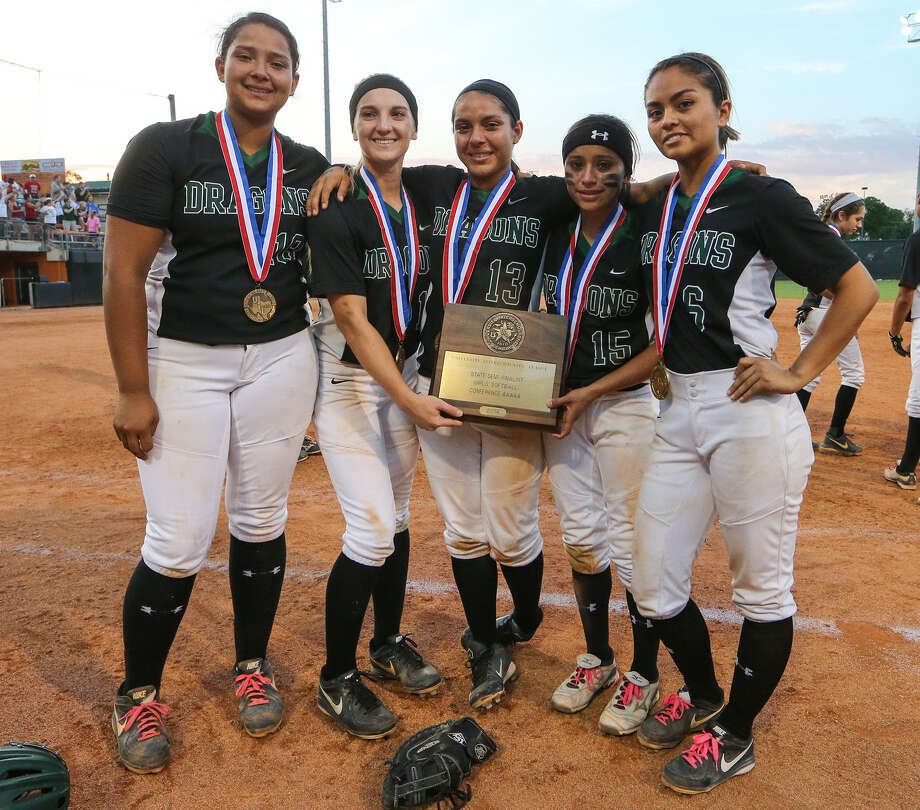 Southwest seniors Kamerie Vidales (from left), Elizabeth Phillips, Kayla Arguello, Amanda Sanchez and Gabby Flores show off their Class 5A state semifinalist trophy in Austin. Photo: Marvin Pfeiffer / San Antonio Express-News / Express-News 2014