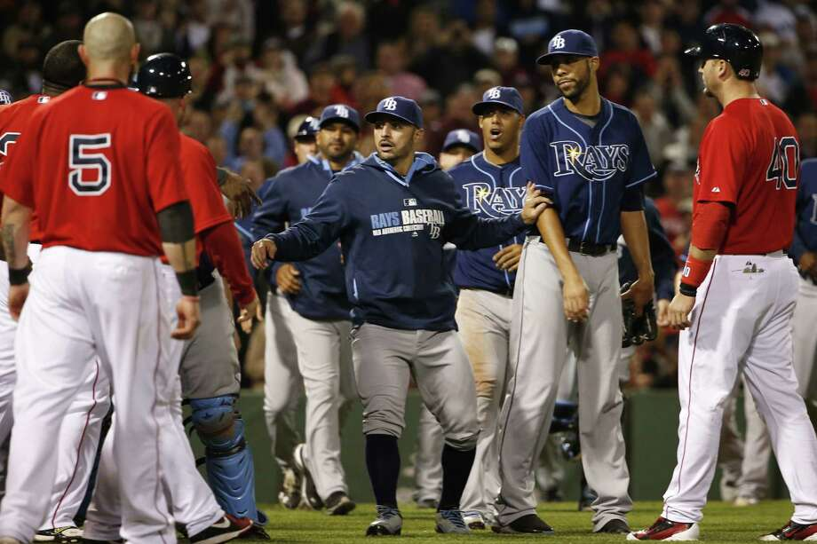 Pitcher David Price (second from right) is held back as the Rays and Red Sox tangle in Boston. Photo: Winslow Townson / Getty Images / 2014 Getty Images