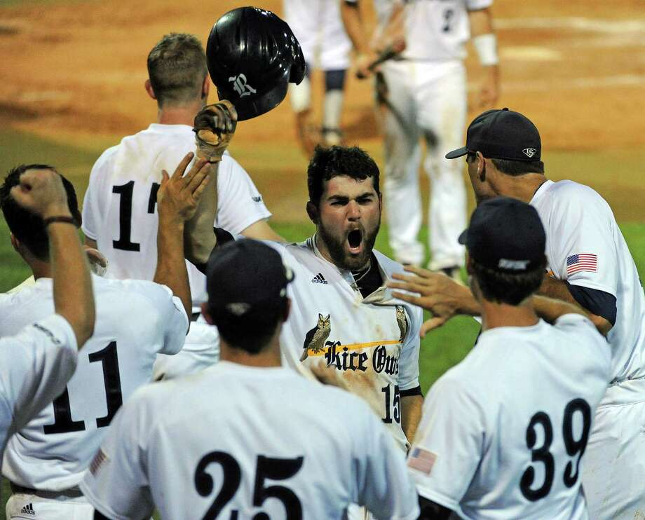 Rice's Michael Aquino (15) celebrates after scoring to put the Owls up in the eight inning. Photo: Eric Christian Smith, Freelance