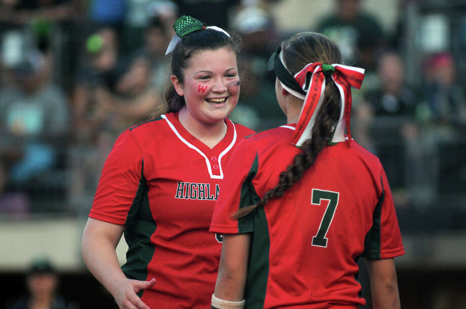 The Woodlands senior pitcher Caitlin Bartsch, left, celebrates a nice defensive play by junior third baseman Kaitlyn Stavinoha in the top of the 6th inning against San Antonio Southwest in their Class 5A UIL State Softball Championship semifinal matchup at McCombs Field in Austin on Friday. Photo: Jerry Baker, For The Chronicle