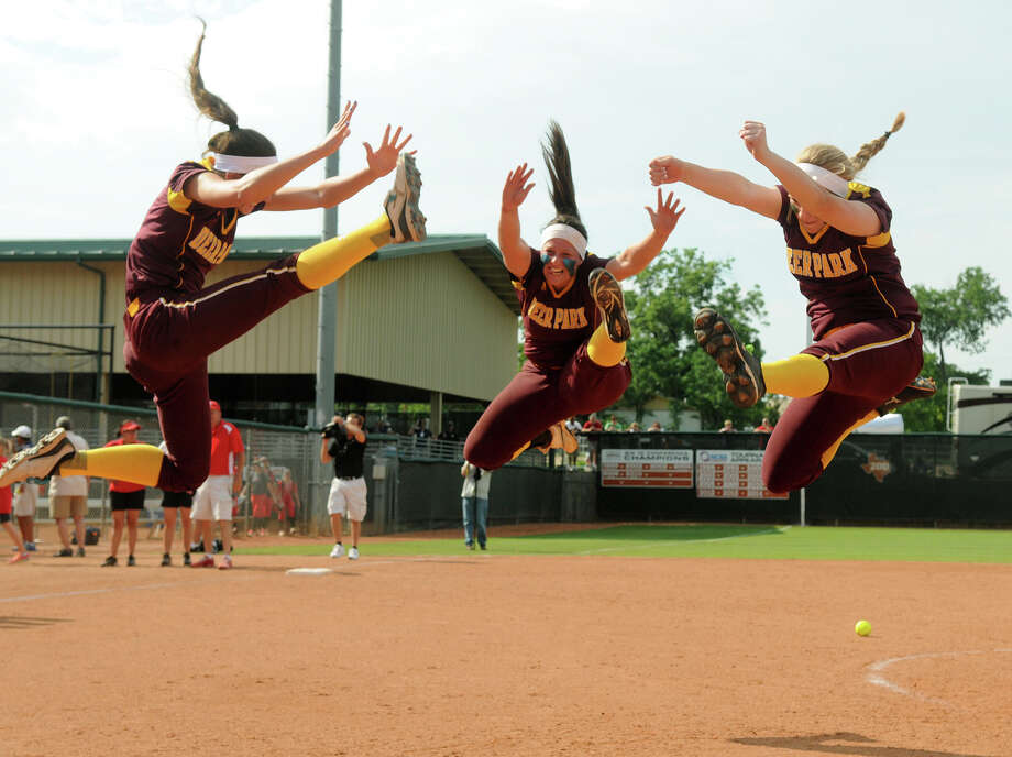 Deer Park's Devann Hebert, from left, Haley Harrison, and Kennedy Dillow perform their traditional post-game herky after the Lady Deer's 6-1 win over Lubbock Coronado in their Class 5A UIL State Softball Championships semifinal matchup at McCombs Field in Austin on Friday. Photo: Jerry Baker, For The Chronicle