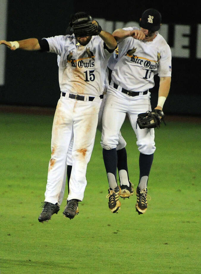 Rice's Michael Aquino (15), Keenan Cook and Leon Byrd celebrate the Owls' 7-2 victory over George Mason in a Houston NCAA baseball regional game, Friday, May 30, 2014, at Reckling Park in Houston. Photo: Eric Christian Smith, For The Chronicle