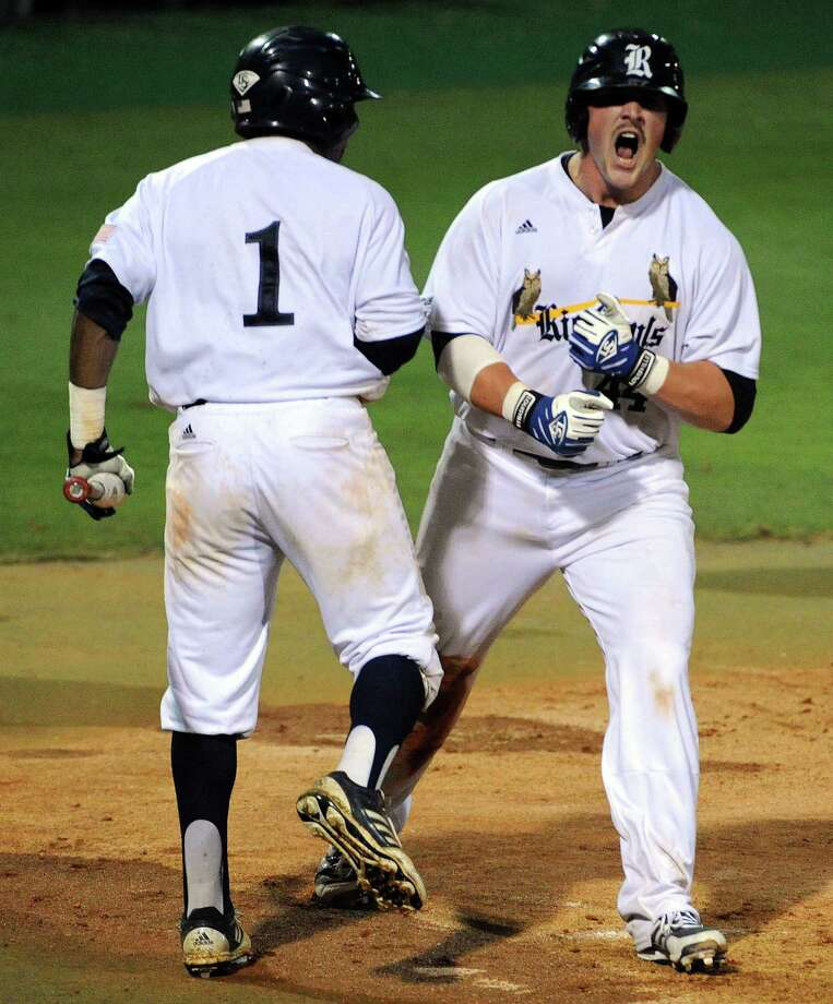 Rice's Skyler Ewing, right, celebrates his run scored with Leon Byrd during the seventh inning of a Houston NCAA baseball regional game against George Mason, Friday, May 30, 2014, at Reckling Park in Houston. Photo: Eric Christian Smith, For The Chronicle