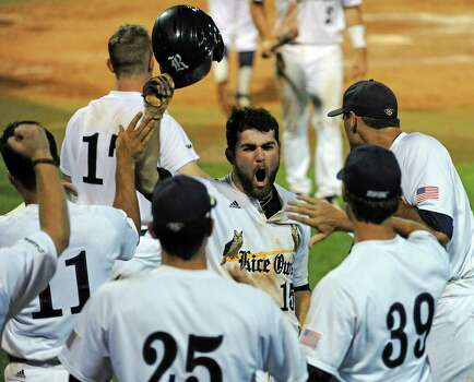 Rice's Michael Aquino (15) celebrates his run scored to put the Owls up 5-2 during the eighth inning of a Houston NCAA baseball regional game against George Mason, Friday, May 30, 2014, at Reckling Park in Houston. Photo: Eric Christian Smith, For The Chronicle