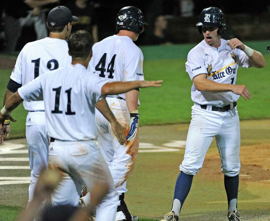 Rice's Keenan Cook, right, celebrates his go-ahead run during the eighth inning of a Houston NCAA baseball regional game against George Mason, Friday, May 30, 2014, at Reckling Park in Houston. Photo: Eric Christian Smith, For The Chronicle