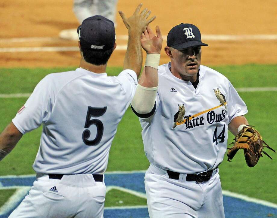 Rice first baseman Skyler Ewing, right, is congratulated by teammate Charlie Warren after Ewing's pickoff of George Mason's Luke Willis during the third inning of a Houston NCAA baseball regional game, Friday, May 30, 2014, at Reckling Park in Houston. Photo: Eric Christian Smith, For The Chronicle