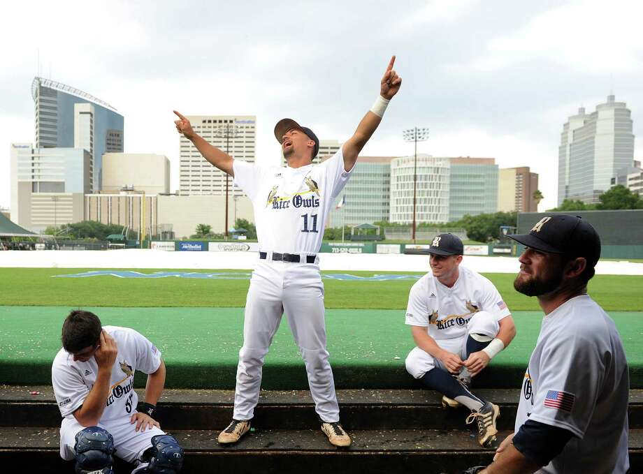 Rice's Ford Stainback (11) jokes around with teammates in the Owls' dugout during a weather delay before the start of a Houston NCAA baseball regional game against George Mason, Friday, May 30, 2014, at Reckling Park in Houston. Photo: Eric Christian Smith, For The Chronicle