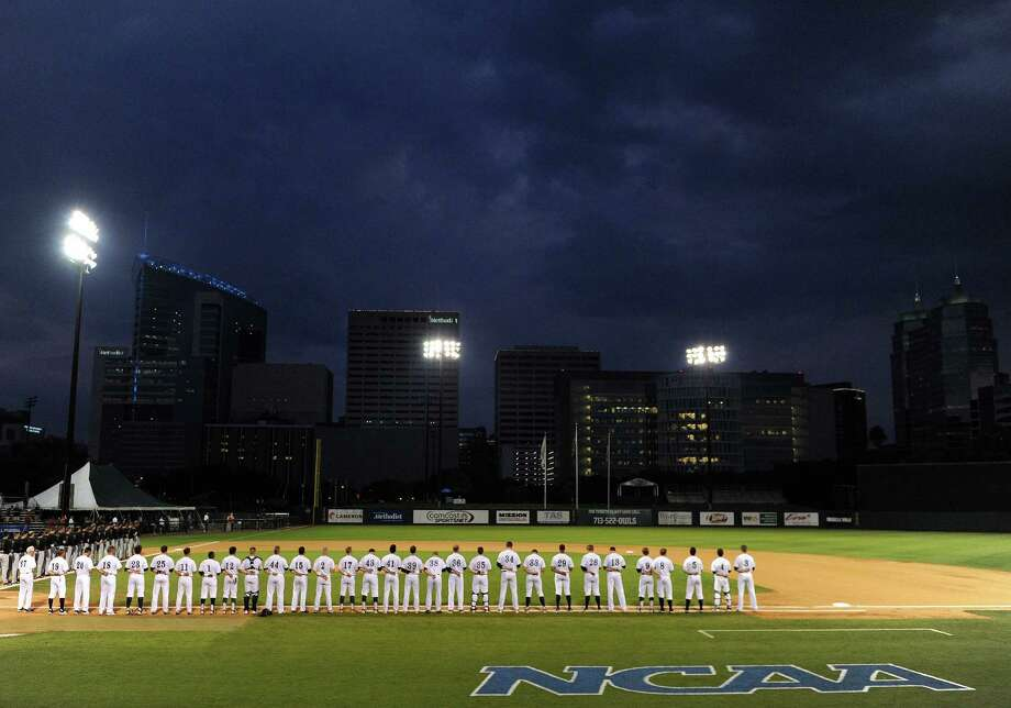 Afetr a 1.5 hour weather delay to the start of their game, The Rice Owls, right, and the George Mason Patriots stand for the national anthem before a Houston NCAA baseball regional game, Friday, May 30, 2014, at Reckling Park in Houston. Photo: Eric Christian Smith, For The Chronicle