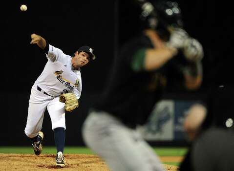 Rice's Kevin McCanna delivers a pitch during the first inning of a Houston NCAA baseball regional game against George Mason, Friday, May 30, 2014, at Reckling Park in Houston. Photo: Eric Christian Smith, For The Chronicle