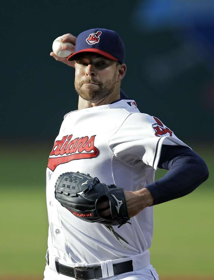 Cleveland Indians starting pitcher Corey Kluber delivers against the Colorado Rockies in the first inning of a baseball game Friday, May 30, 2014, in Cleveland. (AP Photo/Mark Duncan) Photo: Mark Duncan, Associated Press