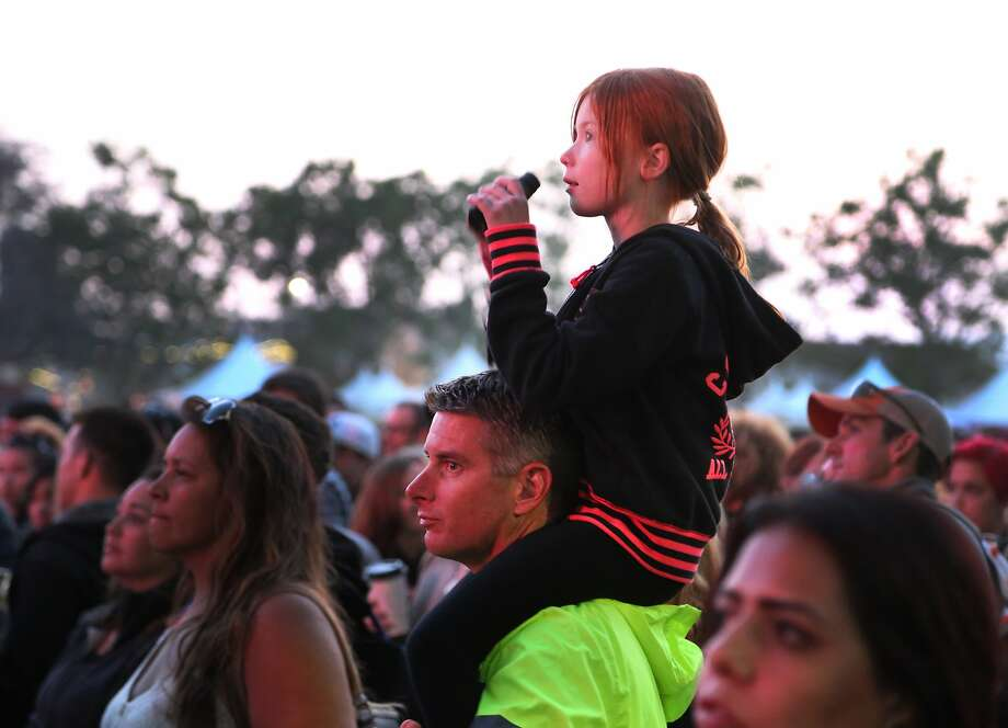 A father holds his young daughter on his shoulders during Sublime with Rome's set at the 2014 Bottlerock Napa Valley music, food and wine festival on Friday, May 30, 2014 in Napa, Calif. Photo: Kevin N. Hume, The Chronicle