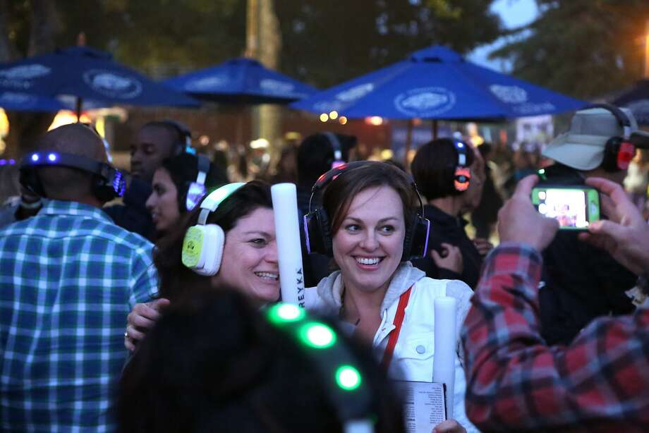 Attendees of a silent disco pose for a picture as night falls at the 2014 Bottlerock Napa Valley music, food and wine festival on Friday, May 30, 2014 in Napa, Calif. Photo: Kevin N. Hume, The Chronicle