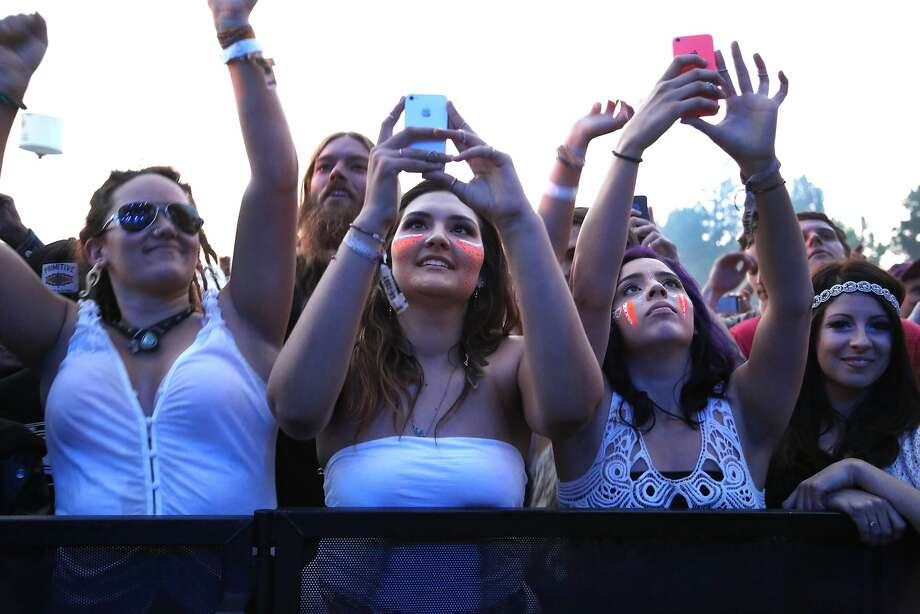 Fans take pictures during Sublime with Rome's set at the 2014 Bottlerock Napa Valley music, food and wine festival on Friday, May 30, 2014 in Napa, Calif. Photo: Kevin N. Hume, The Chronicle